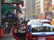 Taksówka na ulicach KL